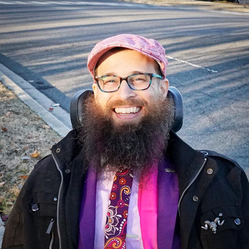 A closeup of Brad smiling.