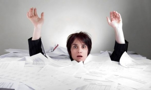 WomanDrowning-in-Paperwork-employers-rx-dot-com