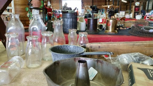 Vintage Glass Milk Bottles and Kitchen Tools at the Flea Market