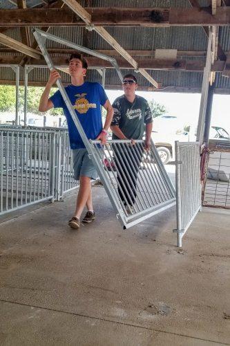 Andy Boschert and friend carry panels