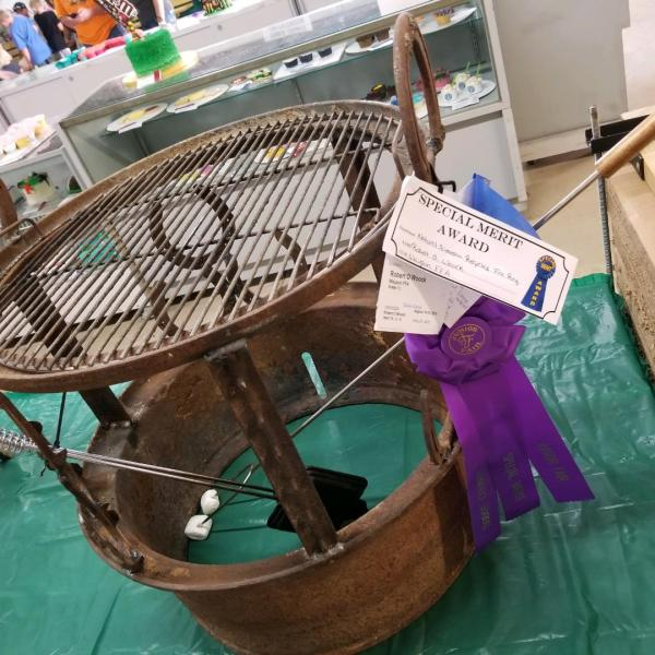Woock wins champion ribbons from turning scrap metal into art