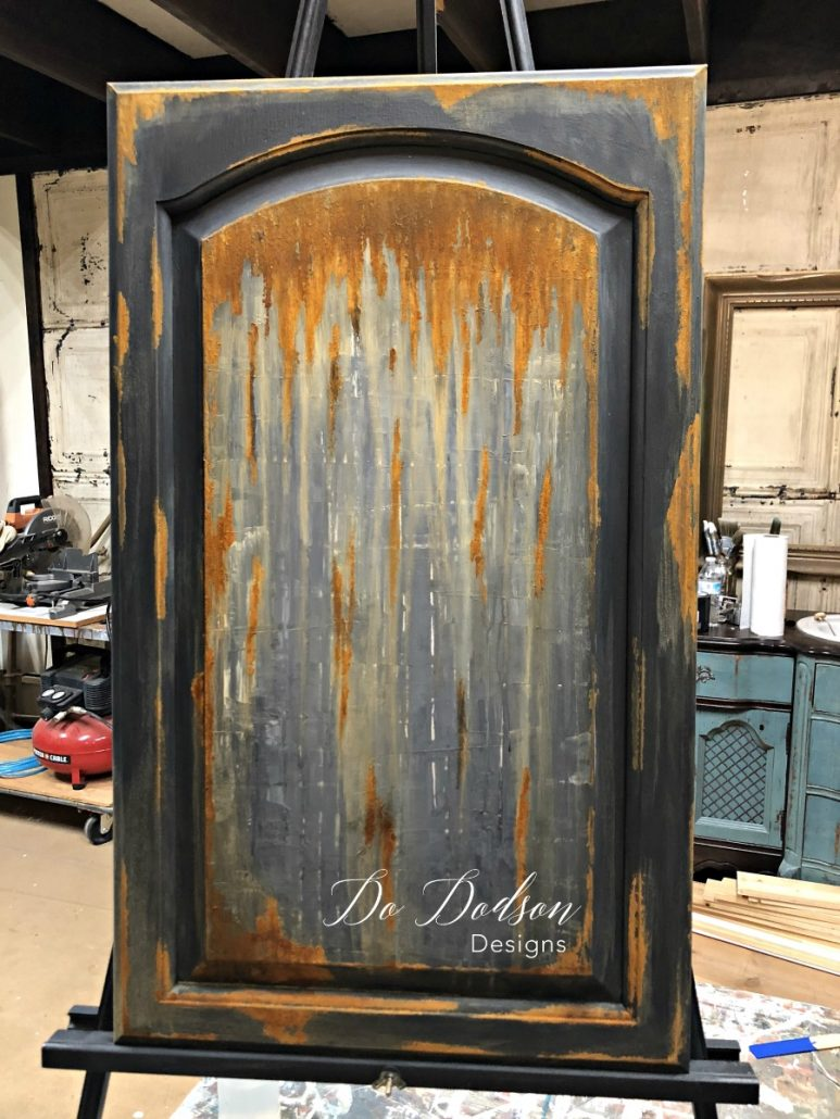 The rusty finish that was created on this cabinet door can be added to almost anything. Even furniture! #dododsondesigns #rustpatina #patina #cabinetdoor #repurposed #diyproject