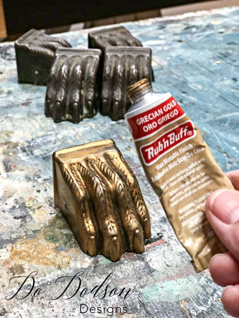 I can't believe what a difference gilding wax made on these antique metal claws. This was the perfect complement to the paint stripes on the table top.