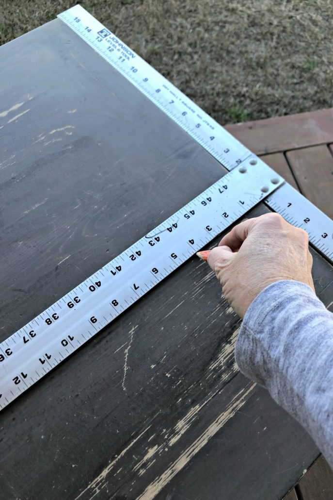 I used a square to make straight lines before cutting the grooves in the table top.