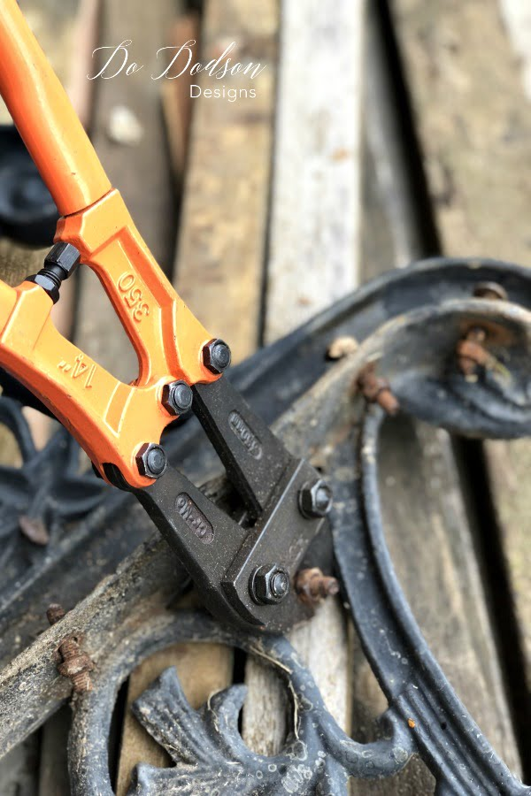 Using my bolt cutters, I quickly removed the rusty bolts from the park bench. I'll be replacing them with new ones.