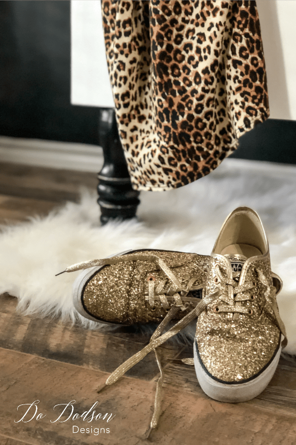 Create staging is a must when staging a headboard bench. These gold glitter shoes are perfect!