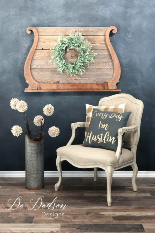 Pallet recycling and an antique mirror harp are a beautiful combination when combined.