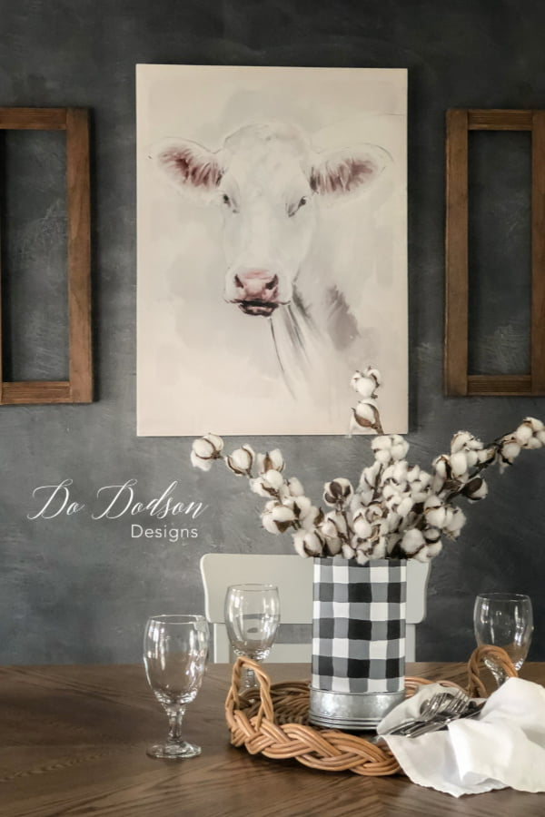 Cow art and a farm table go together like peas and carrots.