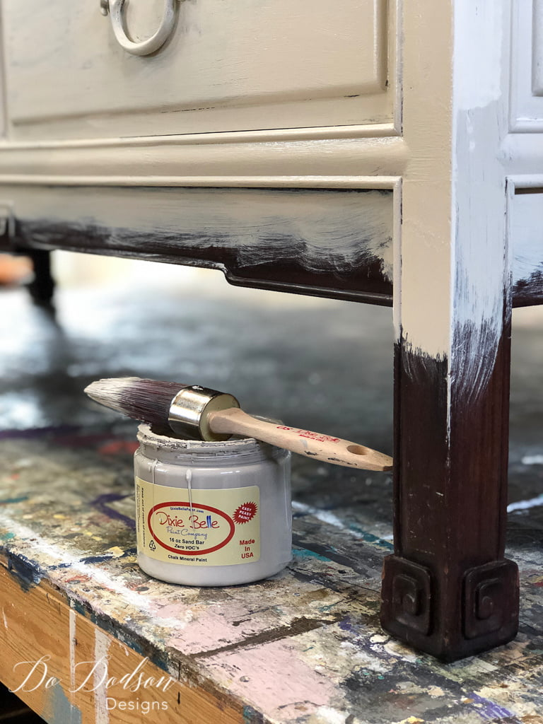 The first step in creating a denim painted look on furniture is to paint a lighter color on the top 2/3 of the piece.