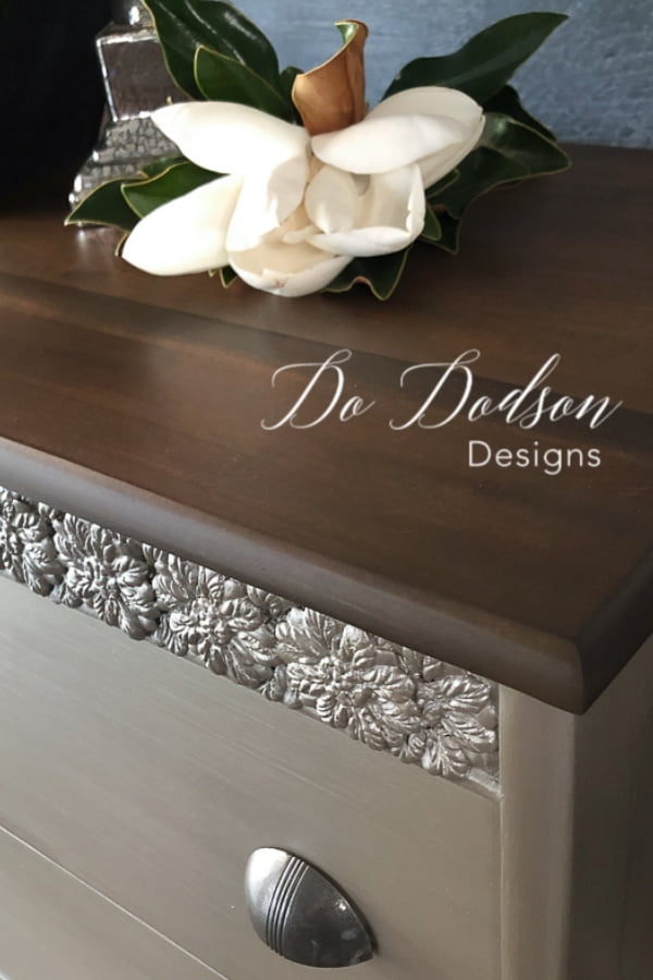 This wood top was refinished with a Gel Stain in Walnut that compliments the beautiful metallic finish on this chest.
