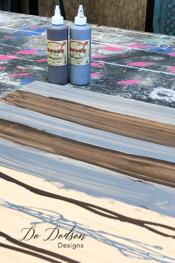 I painted the backer board with a water based gel stain to create a wood grain look.