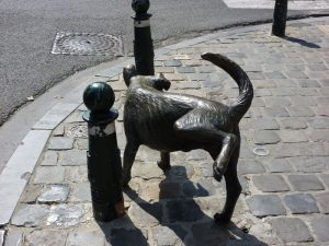 Peeing dog statue