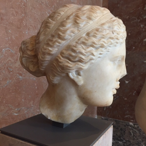 Greek marble bust in the Louvre Musse, Paris, France