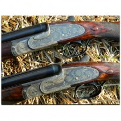 Pair of 20 gauge Woodward Over Under Shotguns