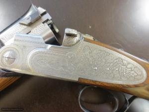 "Beretta SO3. As new condition. 28"" barrels. 100% factory hand engraving"