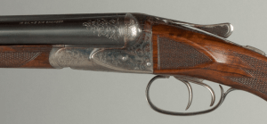 "16 gauge Ansley H. Fox, Philadelphia CE grade Double Barrel Shotgun, Vintage, original blueing & finish, 26"" barrels, 2 3/4"" chamber. Serial #302043"