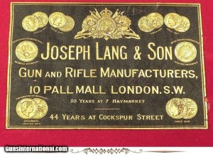 "JOSEPH LANG & SON 450 3 1/4"" BPE- SxS DOUBLE RIFLE  - 1897 DELUXE GRADE BOXLOCK TOPLEVER EJECT- EXC. PLUS BORES- 90% ORIG. CASE COLORS- 95% SUPERB & UNUSUAL ENGRAVING- O&L ORIG. TRUNK"