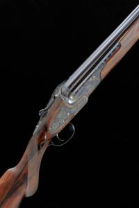 LOT 332: BOSS & CO. A FINE 12-BORE SINGLE TRIGGER SIDELOCK EJECTOR OVER AND UNDER GUN, NO. 9990