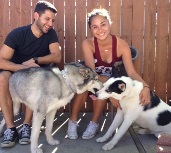 Stella (left) with her new humans and her new sister, Moo. (Photo courtesy ARA)