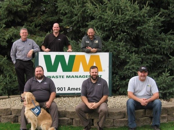 Carl and Jed pose with some colleagues at work. (Photo courtesy Waste Management)