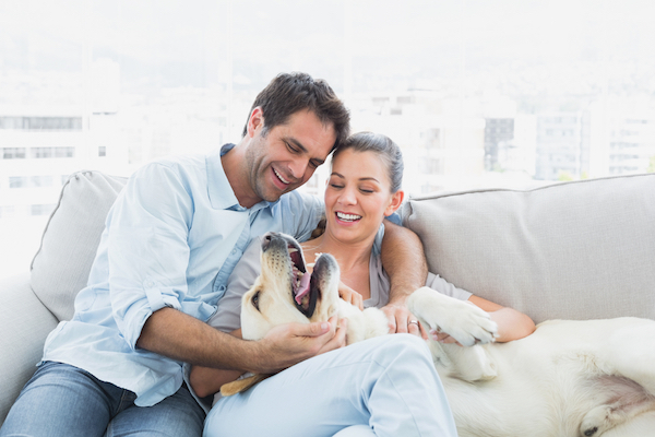 Couple with dog by Shutterstock.