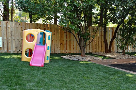 Playground. Our playground is secured by a 6' fence. It is equipped with an artificial turf that we are able to clean and disinfect with a Pet Safe Chlorine Solution.