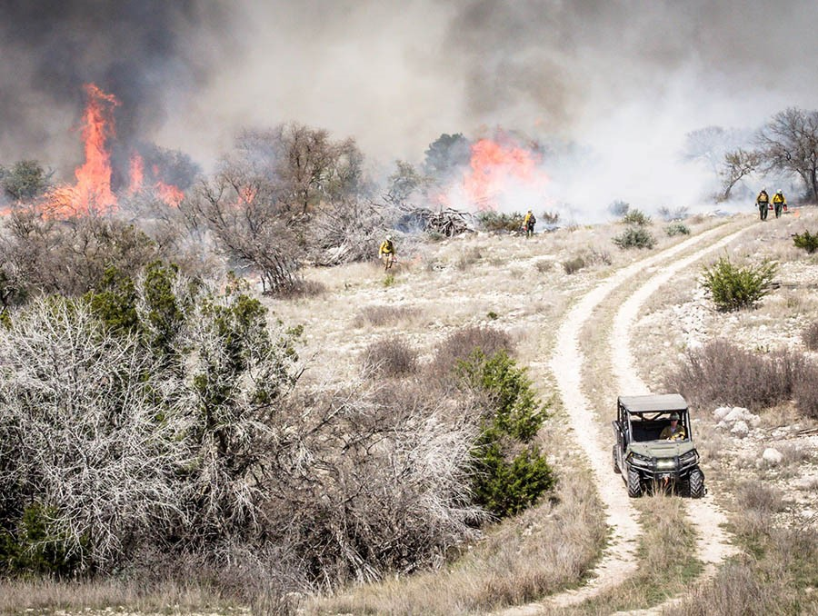 Firefighters monitor a prescribed burn at Balcones Canyonlands National Wildlife Refuge.