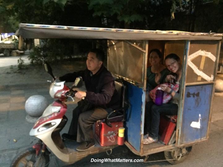 Riding home in a san lun che — a three-wheeled vehicle.