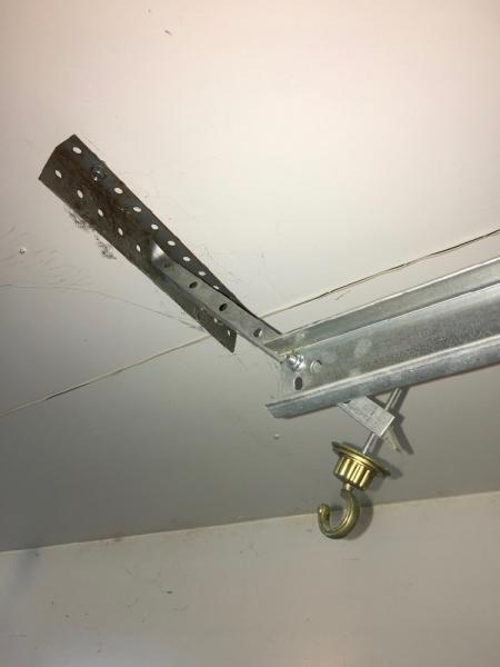 Garage door track hangers location  DoItYourselfcom