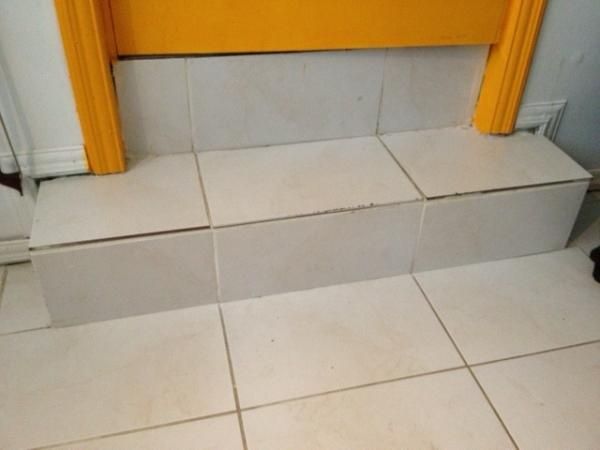 Laminated wood over tile and steps question