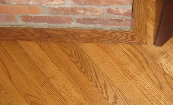 CrookedSlanted hearth  gunstock oak 214 inch hardwood