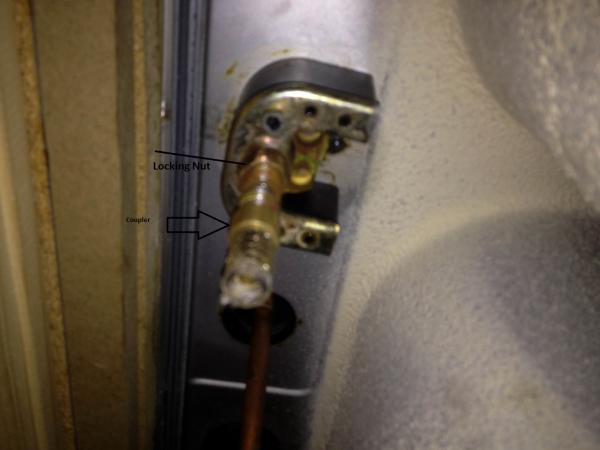 Cant remove kitchen faucet coupler preventing locking nut