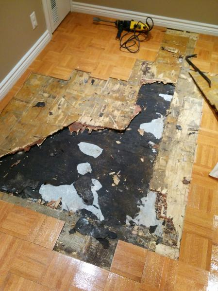 How to remove glued down parquet flooring on plywood