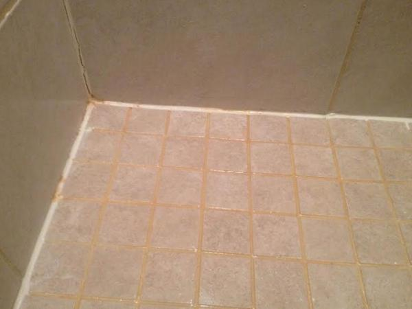 Rust coloring in shower tile grout  DoItYourselfcom