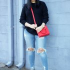 black sweater red bag