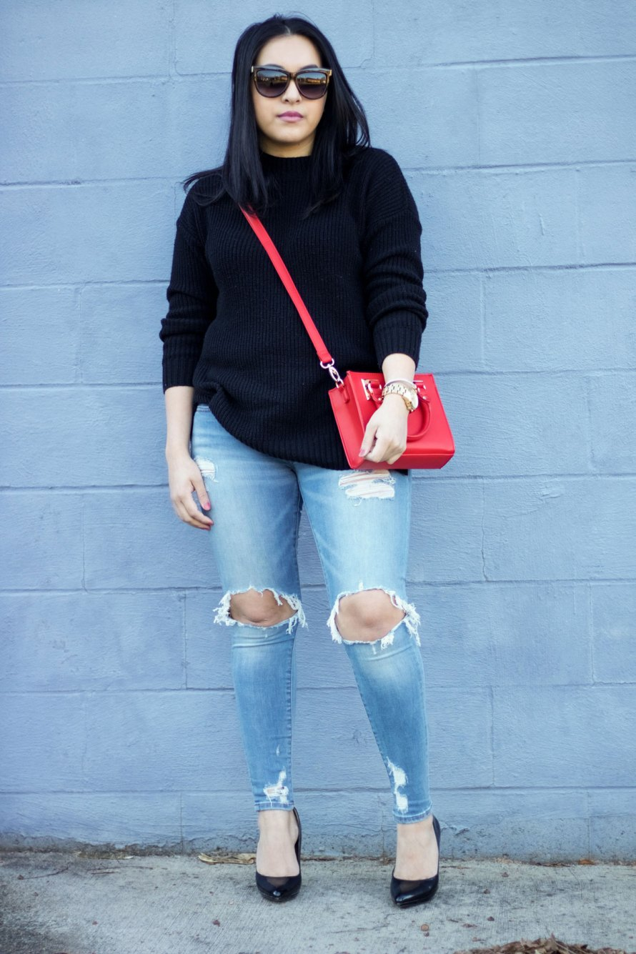 black sweater ripped jeans