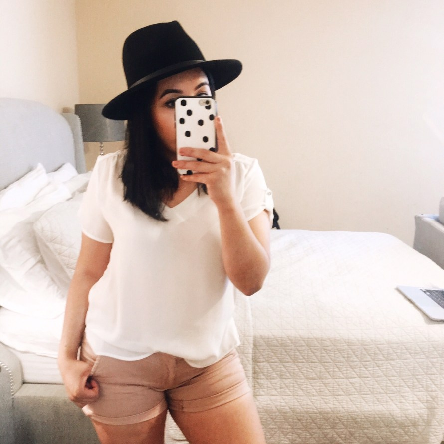 white top pink shorts black hat summer outfit