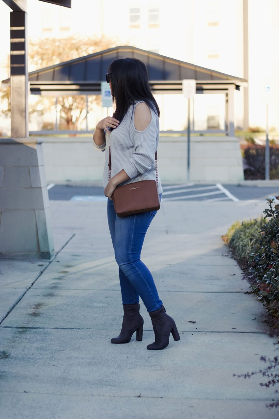 open shoulder gray sweater gray boots skinny jeans casually chic