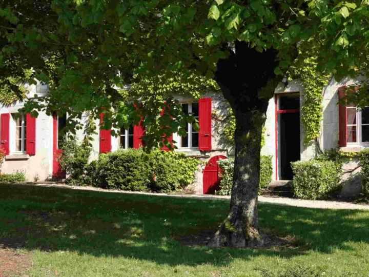 maison volets rouges page d'accueil