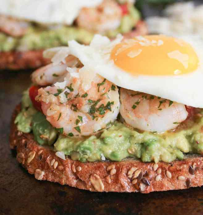 Avocado-Toast-with-Charred-Tomatoes-Garlic-Shrimp-and-Fried-Eggs