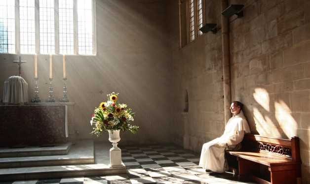 A Dominican friar prays in the presence of the Blessed Sacrament in Blackfriars church, Oxford.