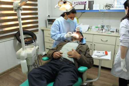 Dr. Widad Operating on a Patient at the Clinic