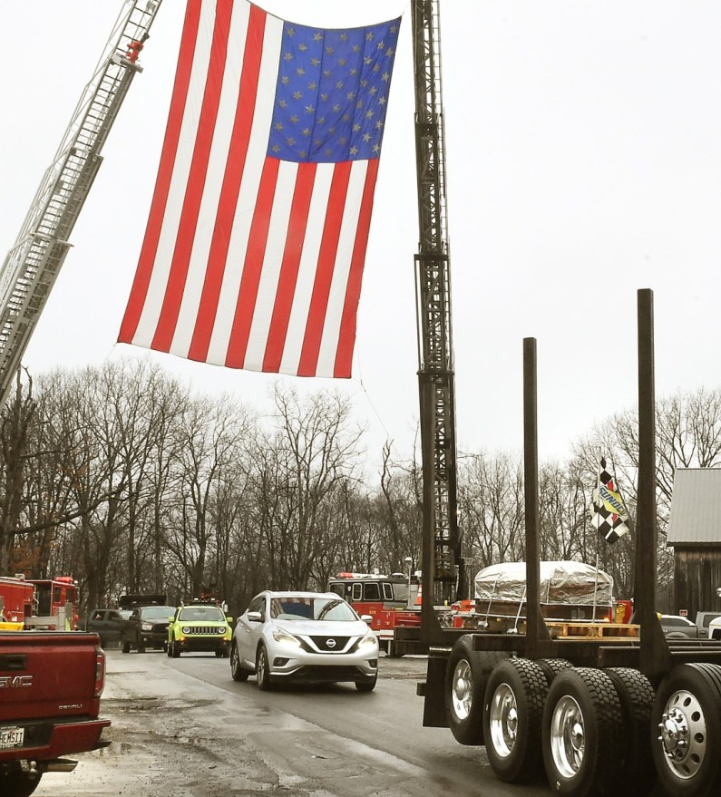 Okey Dalton body passes und drapped flags by volunteer fire department after funeral