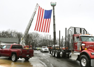 The body of Okey Dalton on logging truck to final resting place.