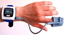 Oximeter which measures the percentage of oxygen being carried by hemoglobin in the blood