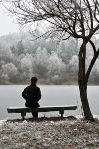 Man sitting alone on bench