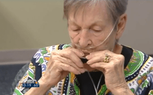Woman with COPD playing a harmonica