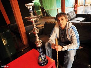 Owner of cafe for hookah smoking