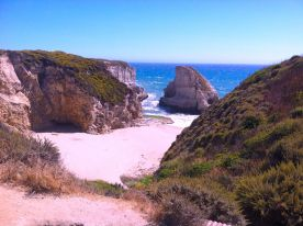 North of Santa Cruz and just south of Davenport. There were a number of paintings of this cove in the show this year.