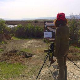 Teresa painting the estuary.